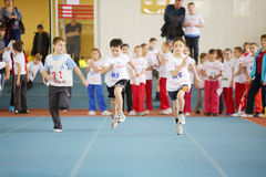 Little boys run in stadium at children competition Royalty Free Stock Photo