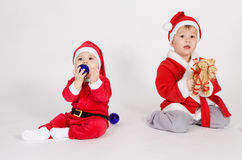 Little boys in Santa clothes Stock Photos