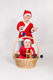 Little boys in Santa clothes Stock Image