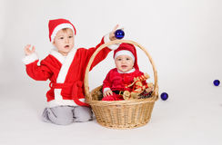 Little boys in Santa clothes Stock Photography