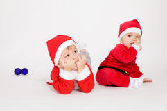 Little boys in Santa clothes Royalty Free Stock Image