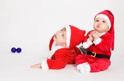 Little boys in Santa clothes Stock Photos