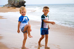 Little boys on seacoast. stock image