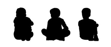 Little boys seated silhouettes set 1. Black silhouettes of three little boys age 5-10 seated on the floor face to the onlooker in different postures Stock Photography
