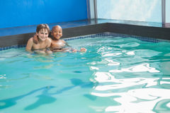 Little boys sitting in the pool Royalty Free Stock Image