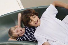 Little Boys Sliding Down A Slide Stock Photography