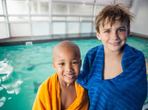 Little boys smiling by the pool Stock Image
