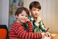 Little boys studing at home Royalty Free Stock Photo