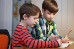 Little boys study math together at desk Royalty Free Stock Photography