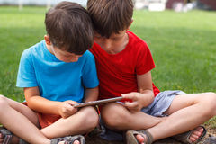 Little boys with tablet Royalty Free Stock Photos