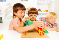 Little boys with toy pliers in classroom Stock Photos