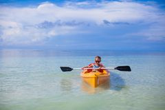 Little brave cute girl floating in a kayak alone Royalty Free Stock Photography