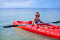 Little brave cute girl floating in a kayak on the Royalty Free Stock Photo