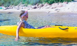 Little brave cute girl kayaking in the clear blue Royalty Free Stock Photo
