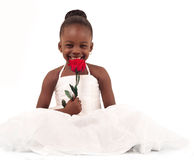 Little bride. Little African American Bride holding a rose flower and smiling
