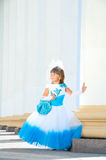 Little bride. A girl in a lush white and blue wedding dress Royalty Free Stock Photos