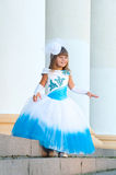Little bride. A girl in a lush white and blue wedding dress Royalty Free Stock Photography