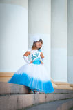 Little bride. A girl in a lush white and blue wedding dress Royalty Free Stock Photo
