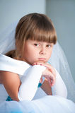 Little bride. A girl in a lush white and blue wedding dress and Royalty Free Stock Photos