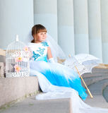 Little bride. A girl in a lush white and blue wedding dress. Royalty Free Stock Photography