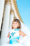 Little bride. A girl in a lush white and blue wedding dress. Royalty Free Stock Photos