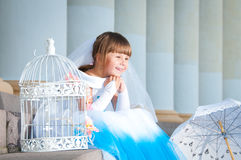 Little bride. A girl in a lush white and blue wedding dress. Royalty Free Stock Images