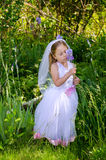Little bride with irises Royalty Free Stock Photos