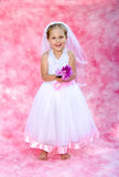 Little bride make believe fun Royalty Free Stock Photos
