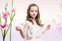 Little bride in white dress with flowers. Royalty Free Stock Image