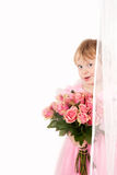 Little bridesmaid. Pretty little girl in pink dress with bunch of roses Stock Photography