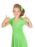 Little bridesmaid with beautiful hair in a green dress shows ges Stock Photography