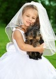 Little bridesmaid with cute dog. Picture of little bridesmaid with cute dog Stock Image
