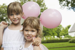 Little Bridesmaids Holding Party Balloons In Garden Stock Photography