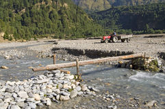 Little bridge through mountain river in Nepal Stock Photography