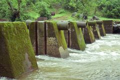 Little bridge over water stream royalty free stock photos