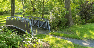 Little bridge in a park Stock Photos