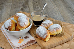 Little brioches breakfast. Breakfast with little sweet and soft brioches and icing sugar Stock Photos