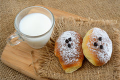 Little brioches breakfast. Breakfast with little sweet and soft brioches and icing sugar Royalty Free Stock Image