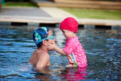 Free Little Brother And Sistor Intimate Moment In Pool Royalty Free Stock Image - 202521176