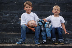 Little brother embracing with the brothers while Stock Photography