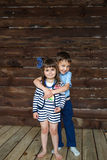 Little brother hugging his little sister. Portrait of a cute little brother hugging his little sister Royalty Free Stock Image