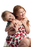 Little brother hugging sister Royalty Free Stock Photos