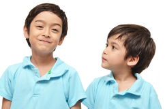 Little brother look at big brother Royalty Free Stock Photo