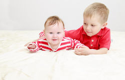 Little brother playing with newborn sister Royalty Free Stock Image