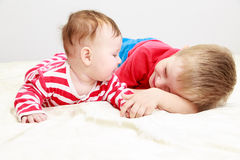 Little brother playing with newborn sister Royalty Free Stock Photos