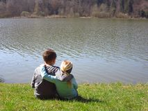 Little brother and sister by the lake royalty free stock photography