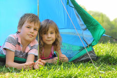 Little brother and sister lying inside tent Royalty Free Stock Photo