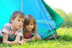 Little brother and sister lying inside tent Royalty Free Stock Photography