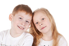 Little brother and sister over white Stock Images