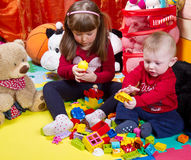 Little brother and sister playing with building bricks Royalty Free Stock Photo